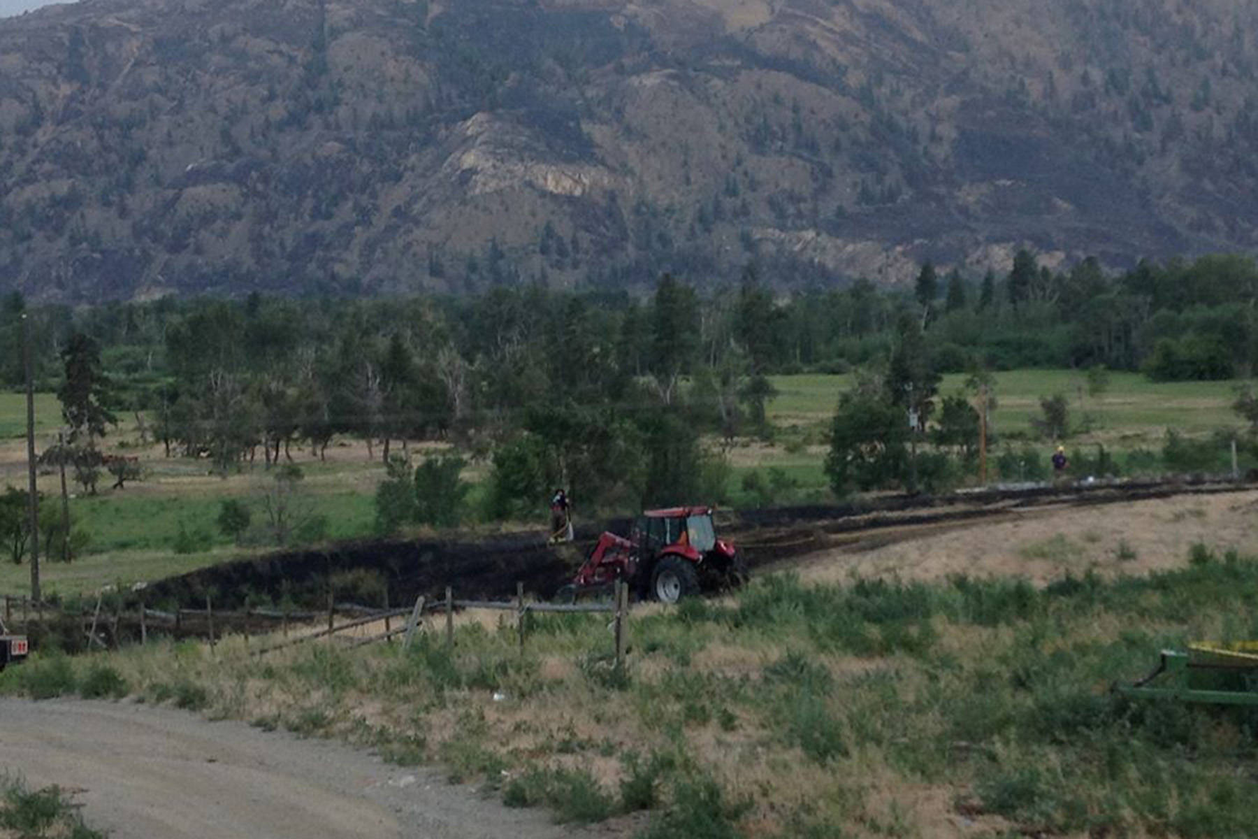 Similkameen grassfire put out within 'a stones throw' from homes