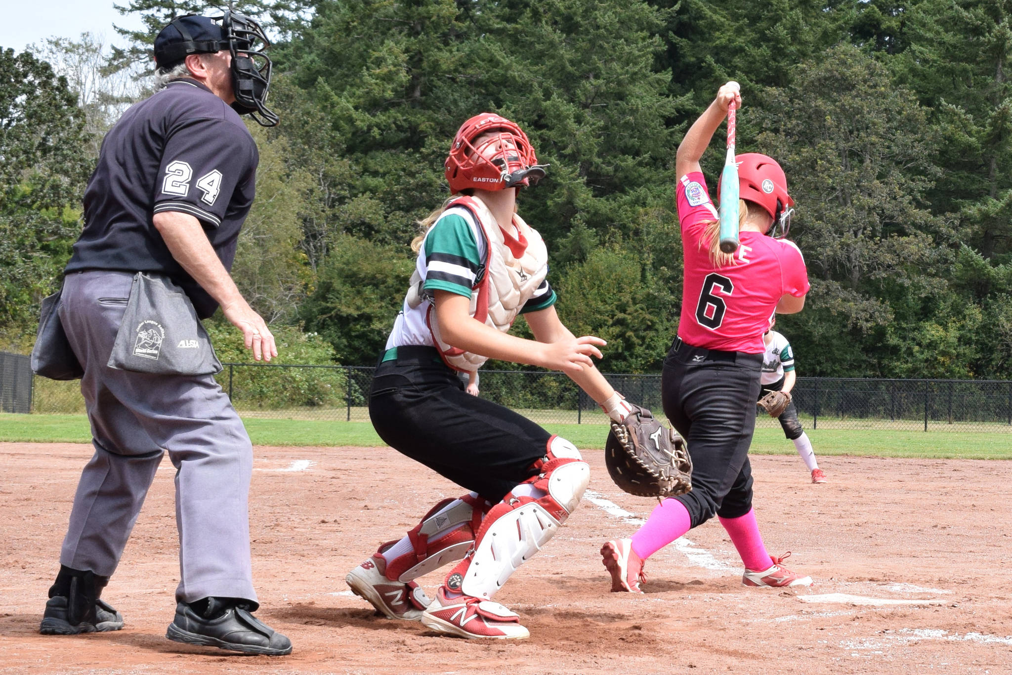 Layritz Little League catcher Zoe Willington searches for a pop-up foul ball from Hampton Little League batter Carissa Dye (#6) at the 2019 Little League Softball Canadian Championships in Saanich on Thursday. Layritz won Thursday's matchup 6-1 but fell in Sunday's championship 2-1. (Kevin Menz/News Staff)